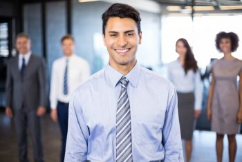 successful-business-man-smiling-while-her-colleagues-standing-him-office_107420-8503.jpg